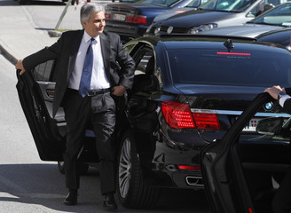 Austrian Chancellor Faymann arrives for a government meeting in Semmering