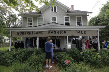 People shop for clothes ahead of the arrival of Hurricane Irene in Amagansett
