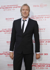 """Cast member Rhys Ifans poses at the premiere of """"The Amazing Spider-Man"""" at the Regency Village theatre in Los Angeles"""