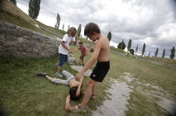 Children play in the ruins of an ancient Roman amphitheatre in the former Roman army camp of Carnuntum