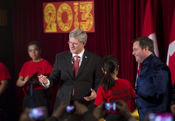 Canadian Prime Minister Stephen Harper and Minister Jason Kenney look to the crowd after dotting the eye of a dragon during a Chinese New Year celebration in Burnaby.