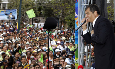Ecuador's President Rafael Correa addresses supporters during a gathering at the main square of Quito