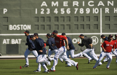 Boston Red Sox players loosen up before a MLB spring training game against the Tampa Bay Rays in Fort Myers, Florida