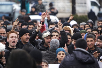 People shout slogans during a protest after Friday prayers, calling for the lifting of the siege off Madaya, in the rebel-controlled area of Maaret al-Numan town in Idlib province