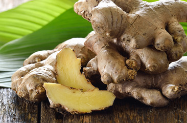 Fresh ginger root on wooden background