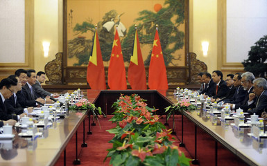 China's President Xi Jinping and East Timor's Prime Minister Kay Rala Xanana Gusmao attend a meeting in Beijing