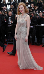 """Actress Jessica Chastain poses on the red carpet as she arrives for the screening of the film """"Money Monster"""" out of competition during the 69th Cannes Film Festival in Cannes"""