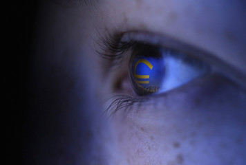 Picture illustration shows Euro currency logo reflected in a person's eye, in the central Bosnian town of Zenica