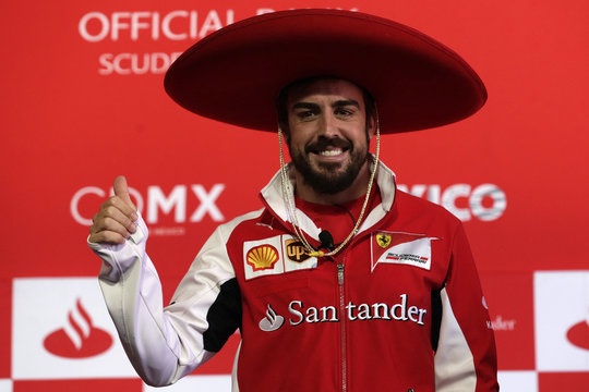 Ferrari Formula One driver Fernando Alonso of Spain wears a traditional Mexican hat during a news conference at the Hermanos Rodriguez racetrack in Mexico City