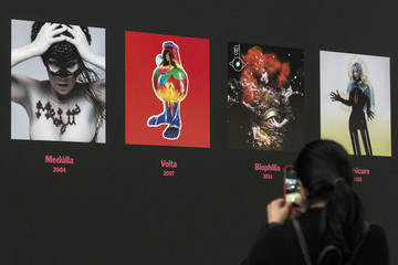 A woman photographs artwork displayed during the exhibition 'Bjork' during a preview at the Museum of Modern Art in New York