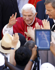 Pope Benedict XVI waves to the crowd after celebrating a mass at the San Tommaso da Villanova Church in Castel Gandolfo