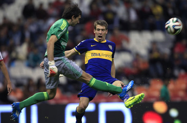 Marcelo Barobero of Argentina's River Plate clears the ball past Claudio Riano of Argentina's Boca Juniors during their international friendly soccer match in Mexico