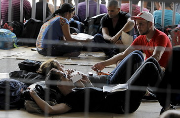 Cuban migrants wait to receive a humanitarian visa at the border post with Panama in Paso Canoas, Costa Rica