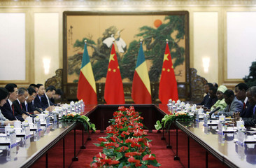 Benin's President Boni attends a meeting with Chinese counterpart Hu at the Great Hall of the People in Beijing