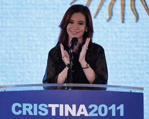 Argentina's President Fernandez applauds her supporters after winning the presidential election in Buenos Aires