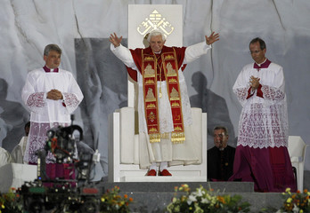 Pope Benedict XVI waves to a crowd of pilgrims at the start of a prayer vigil in Madrid
