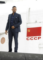 """U.S. actor Will Smith poses during a photo call to promote """"After Earth"""" on the mainplane of Buran space shuttle in Moscow"""