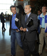 Federal Reserve Chairman Ben Bernanke speaks with Professor of International Economics at Catholic University of Buenos Aires Martin Redrado as they exit the Federal Reserve Bank of Kansas City Economic Policy Symposium in Jackso
