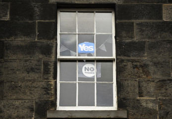 "Placards showing 'Yes"" and ""No"" are displayed in a house window in central Edinburgh"
