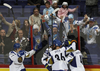 Kazakhstan's players and supporters celebrate scoring against the U.S. during their 2012 IIHF men's ice hockey World Championship game in Helsinki