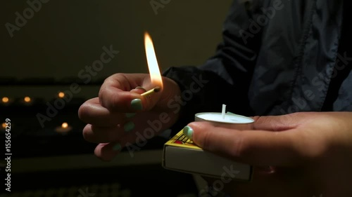 Young Woman Lights A Prayer Candle At The Oude Kerk (Old