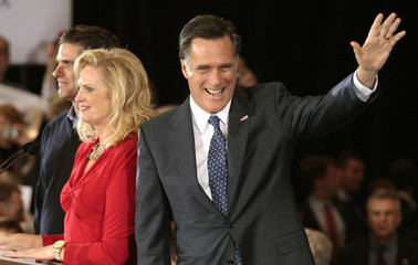 U.S. Republican presidential candidate and former Massachusetts Governor Mitt Romney arrives with his wife Ann and son Tag to address supporters at his Michigan primary night rally in Novi