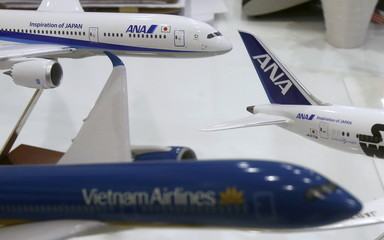 Models of ANA's aircrafts are seen next to a model of Vietnam Airlines aircraft at a ticket office in Hanoi