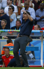Germany's coach Joachim Loew reacts to a shot hitting the goalpost during the 2014 World Cup final between Argentina and Germany at the Maracana stadium in Rio de Janeiro