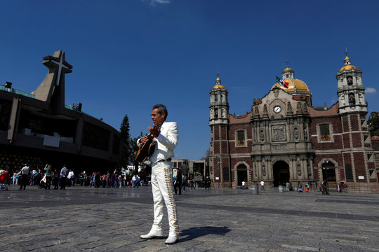 A mariachi plays a guitar at the Basilica of Our Lady of Guadalupe to celebrate Santa Cecilia, patron of musicians in Mexico City, Mexico