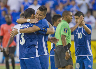 Turcios and Henriquez Dubon of El Salvador celebrate after defeating Haiti in their CONCACAF Gold Cup soccer game in Houston, Texas