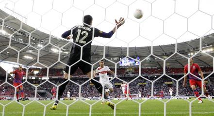 Stuttgart's Ibisevic scores goal against Steaua Bucharest's goalkeeper Tatarusanu during Europa League soccer match in Stuttgart