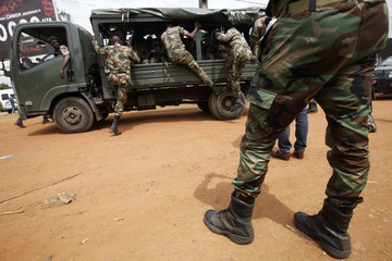 Soldiers patrol near the Akouedo camp after an attack in Abidjan