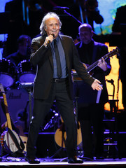 Joan Manuel Serrat performs for the crowd at the conclusion of the 2014 Latin Recording Academy Person of the Year Tribute in his honor in Las Vegas