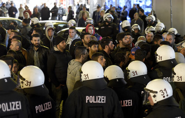 Kurdish people face German riot police as they demonstrate in solidarity with the people of the Syrian Kurdish town of Kobani, in Hamburg