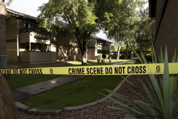 Crime scene tape surrounds buildings at the Autumn Ridge apartment complex which had been searched by investigators in Phoenix