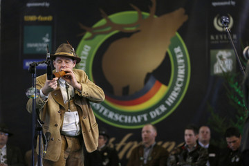 "A competitor uses a specially designed instrument at the German championships in Deer-Calling at the ""Jagd & Hund"" exhibition in Dortmund"