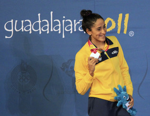 De Paula of Brazil poses with her silver medal after the women's 100m butterfly final at the Pan American Games in Guadalajara
