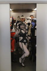 """A group of people dressed as a Star Wars characters stand in an elevator at the cartoon fair """"Vienna Comix"""" in Vienna"""