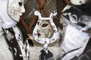 Masked revellers pose during the Venice Carnival, in San Marco Piazza