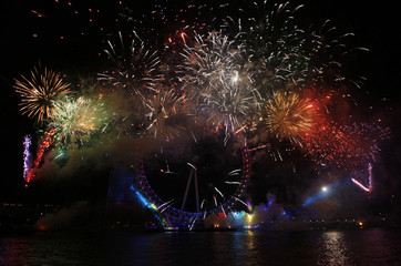 Fireworks explode in front of the London Eye on the River Thames during New Year celebrations in London