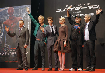 "Director Webb waves to fans alongside cast members Ifans, Garfield and Stone and producers Arad and Tolmach at the world premiere of ""The Amazing Spider-Man"" in Tokyo"