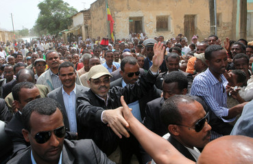 Ethiopia's PM Zenawi greets his supporters as he arrives to cast his vote in the northern Ethiopian town of Adwa