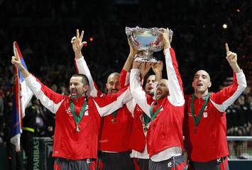 Serbia's team members celebrate with the Davis Cup trophy in Belgrade