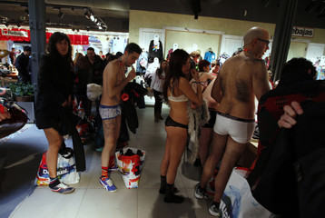 People in their underwear line up in a clothing store in the Andalusian capital of Seville