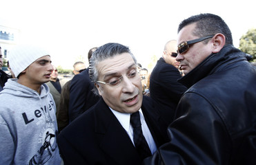 Nabil Karoui, the head of Tunisian station Nessma TV, arrives at court in Tunis