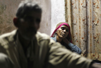 Mange Lal Singh and Ram Bai, father and mother of Ram Singh, the driver of the bus in which a young woman was gang-raped and fatally injured three months ago, sit inside their house in New Delhi