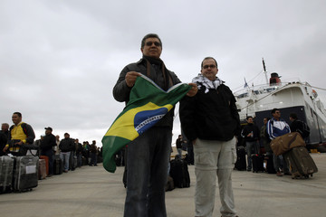 Brazilian evacuees from Libya disembark at the port of Piraeus near Athens