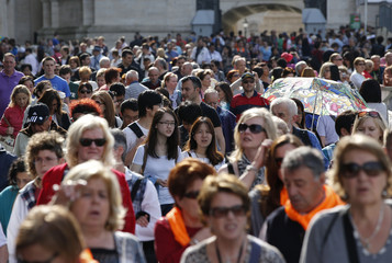 Tourists walk in St. Peter's Square at the Vatican