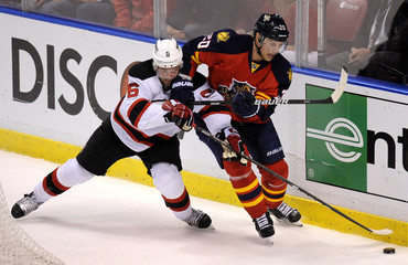 Florida Panthers Sean Bergenheim and New Jersey Devils Martin Dainius Zubrus fight for the puck during the third period of their NHL Eastern conference quarterfinal playoff hockey game 2 in Sunrise