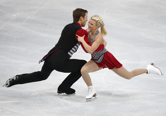 Moore-Towers and Moscovitch of Canada perform during the pairs short skating program at the ISU Grand Prix of Figure Skating Rostelecom Cup in Moscow